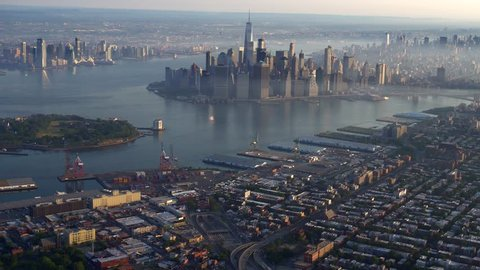 Manhattan Downtown and Brooklyn dawn AERIAL WIDE. 4K 100 mps aerials of NYC. From dedicated aircraft, no plastic windows, gyro stabilized.