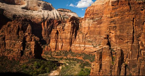 Zion National Park, Utah, USA - view at Zion Canyon Scenic Drive in the valley with Shuttlebus at sunny day with blue sky - Timelapse with zoom out