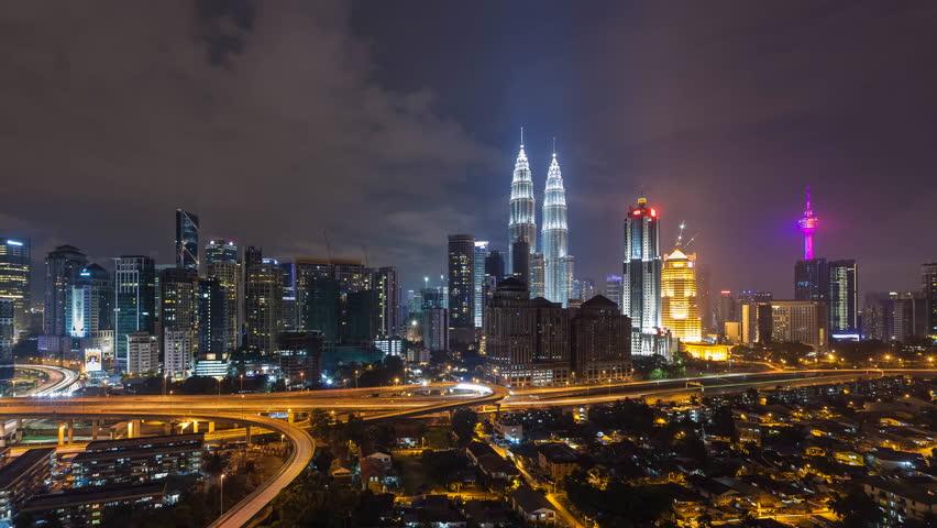 Time lapse: Beautiful and dramatic sunset view of the Kuala Lumpur skyline overlooking the national landmarks, the Petronas Towers and Kuala Lumpur Tower.