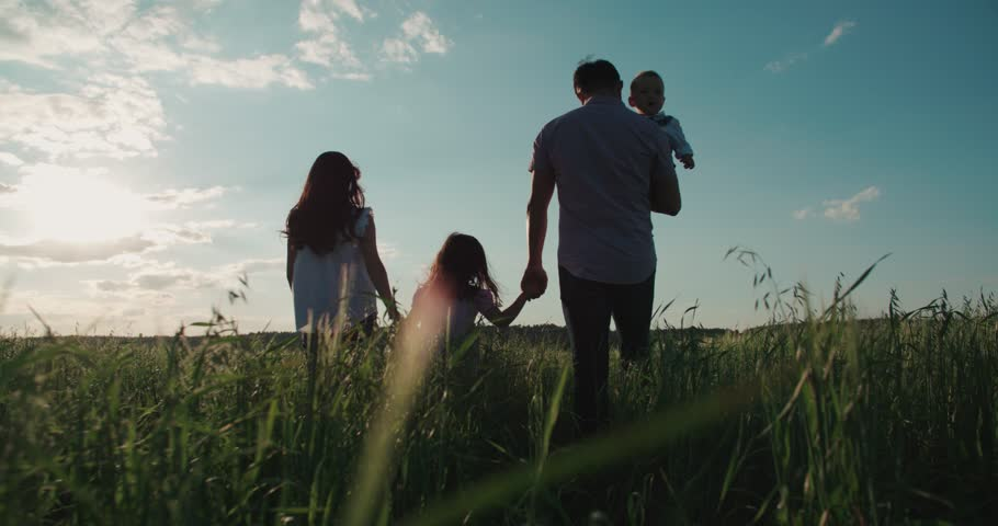 Young happy Asian family goes on a green field with two children, slow motion | Shutterstock HD Video #17745724