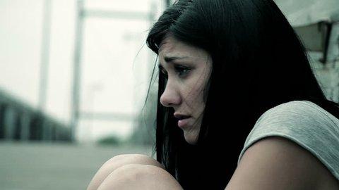 Sad desperate woman feeling lonely sitting on street
