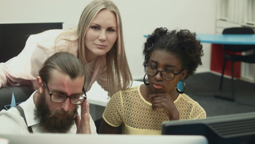 Multiracial group of people using computer, talking and smiling | Shutterstock HD Video #17774500