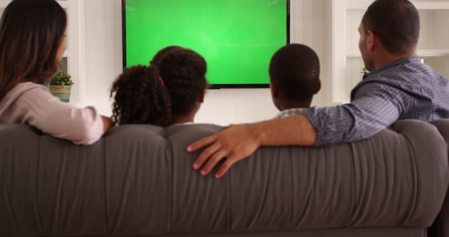 Rear View Of Family Watching Green Screen TV Shot On R3D | Shutterstock HD Video #17786479