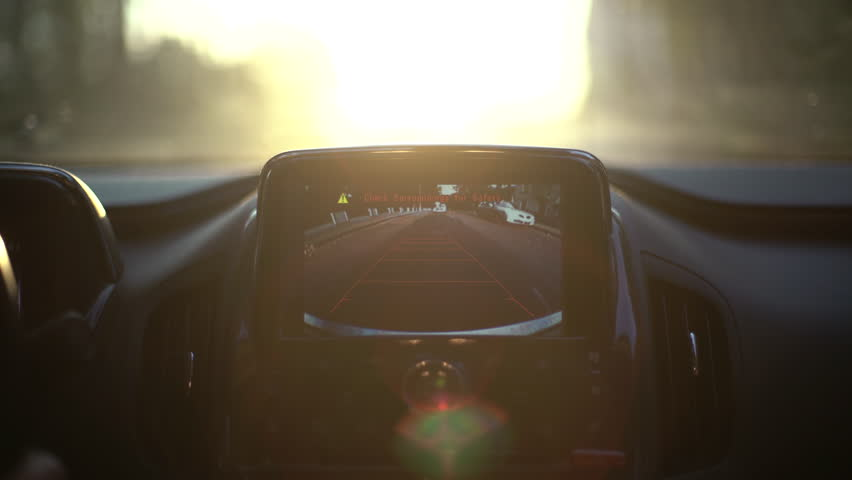 A car's backup camera in action at sunset. Close up   Shutterstock HD Video #17794726