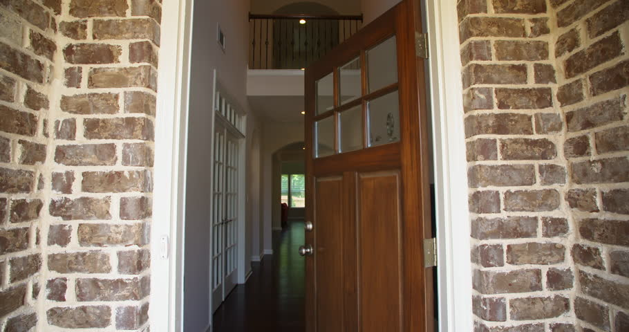 Front Home Entrance Low Angle Door Open Rise Up. rising low angle shot of the front entrance as the door opens to reveal the hallway of a modern residential home   | Shutterstock HD Video #17798623