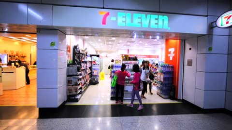 HONG KONG, CHINA - MARCH 31, 2016: 7-Eleven store in Hong Kong mall. Walking between shelves and aisles with goods. 7-Eleven an international chain of convenience stores.