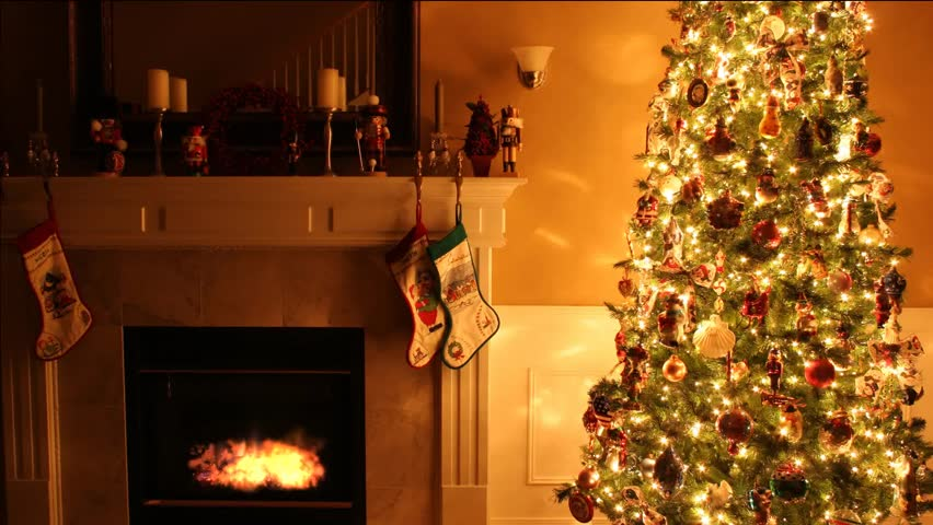 Merry Christmas beautiful video with animated fireplace, Xmas tree with garland, pleasant atmosphere and luminous fire. Best use for Xmas gifts and titles with a greeting inscription.