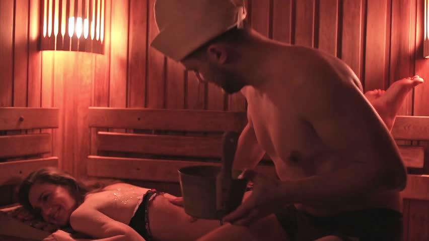 beautiful caucasian couple relaxing in sauna spa