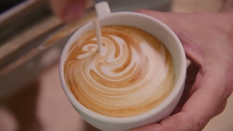 Making of cafe latte art, heart shape