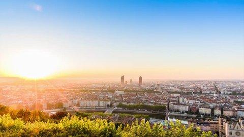 LYON, FRANCE, JULY 9, 2016 : Timelapse sunrise. From Basilique Notre Dame de Fourvière to the city view, the mountain near Lyon.