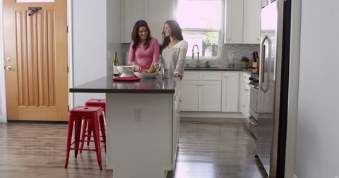 Lesbian couple preparing meal together at home, full length, shot on R3D