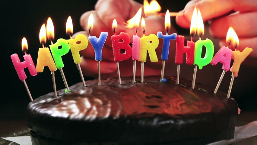 Lighted Candles On A Happy Birthday Cake With The Words Chocolate Hand Lights Candle