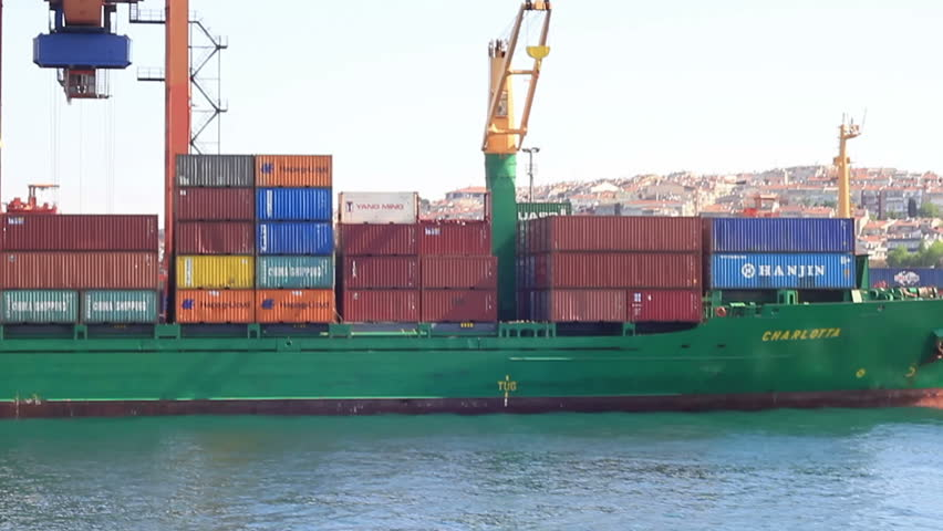 ISTANBUL - MAY 23: Container ship Charlotta unloads Chinese export goods on May