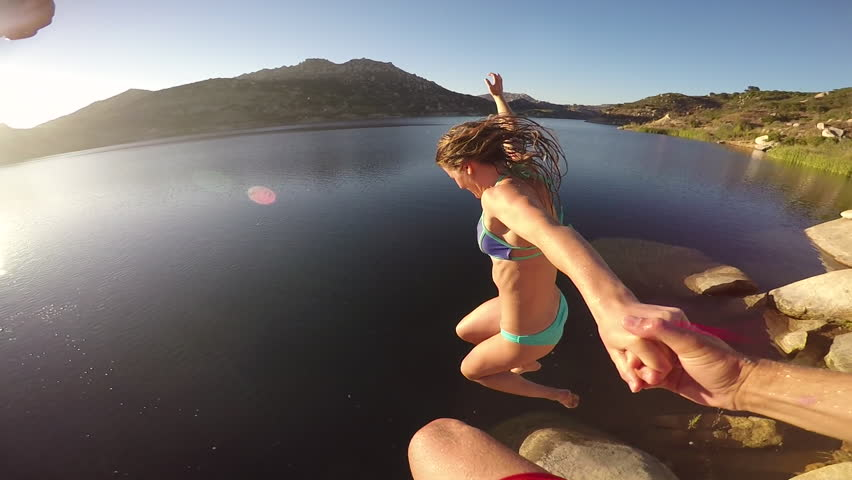 POV Couple Holding Hands Jumping Into Lake
