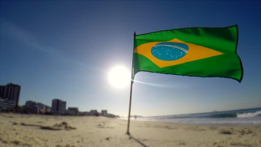 Brazilian flag blowing in the wind in morning sun on Ipanema Beach in Rio de Janeiro, Brazil | Shutterstock HD Video #17972536