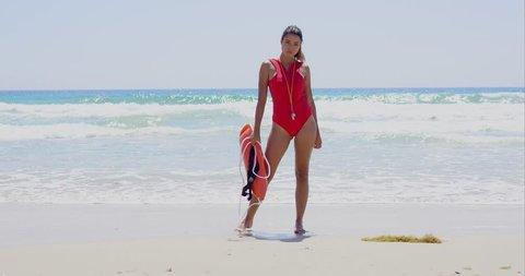 Beautiful lifeguard wearing red swim suit