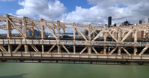 NEW YORK - Circa July, 2016 - A unique aerial side view of traffic on the Ed Koch Queensboro Bridge as seen from the Roosevelt Tramway.
