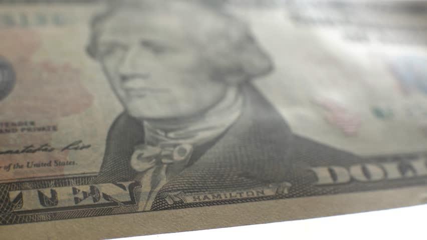 10 dollar bill. Macro.Fingers paw bill.   Shutterstock HD Video #18070396