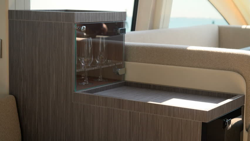 Fancy Wooden Furniture With Wine Glasses On A Boat   4K Stock Footage Clip