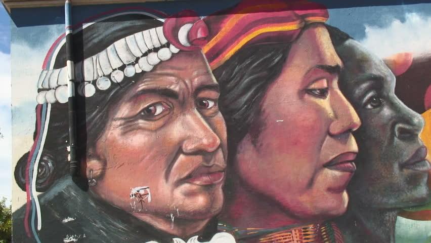VALPARAISO, CHILE -  CIRCA 2010: A beautiful wall painting in Valparaiso, Chile depicting indigenous people