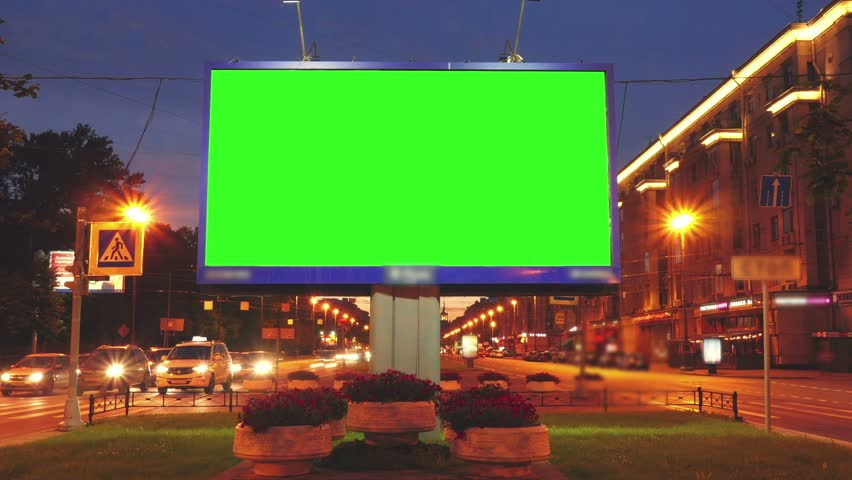 A Billboard with a Green Screen on a Busy Street.Time Lapse. | Shutterstock HD Video #18116566
