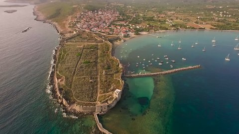 Aerial view from Methoni's Castle in Peloponnese, Greece. The fortress is located by the wonderful sea with rich coloured water. Forward motion.