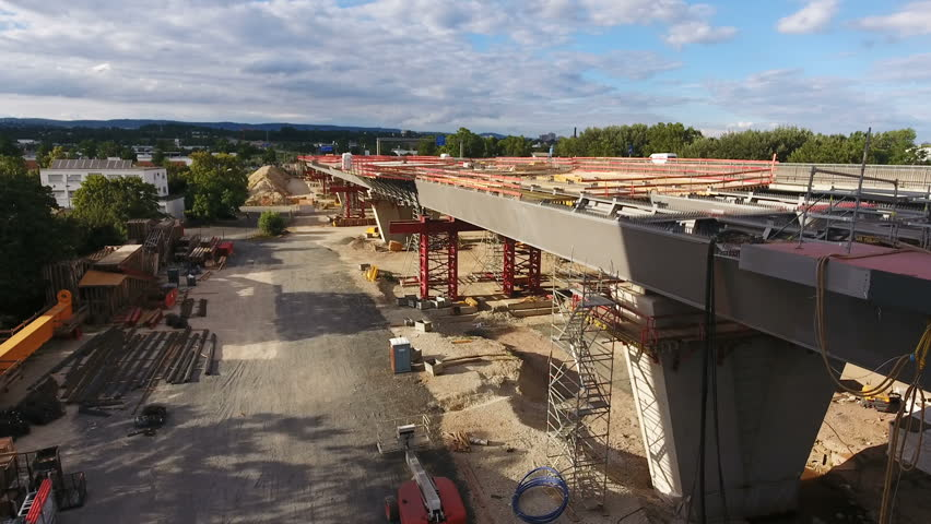 Wiesbaden, Germany - July 17, 2016: Aerial view of large bridge construction site Schiersteiner Bruecke, Germany - it connects the cities Wiesbaden and Mainz. Completion is scheduled for 2019 #18170146