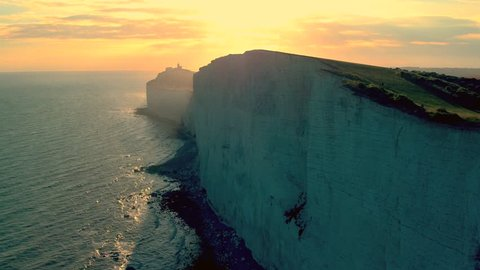 White chalk cliffs and Beachy Head Lighthouse. Eastbourne, East Sussex, England