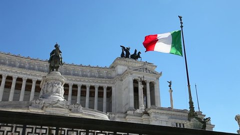 National Monument with italian flag Altar of the Fatherland, Vittoriano, the Italian patriotic symbols in Rome city