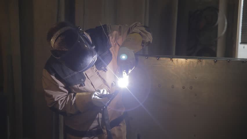 worker with protective mask welding metal #18233626