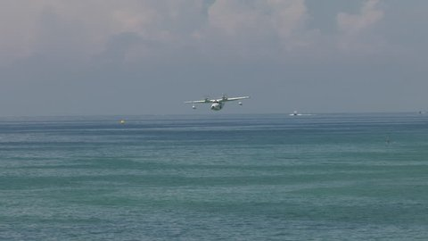 Seaplane low to the water flyby