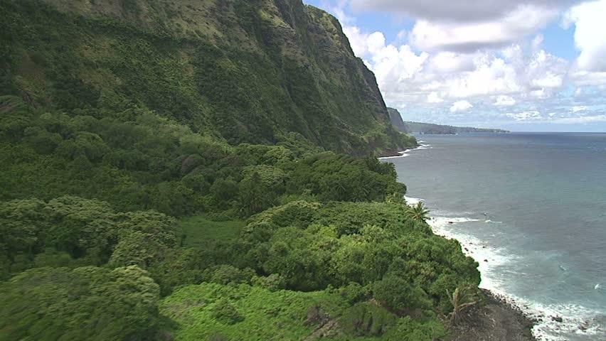 Low flying aerial of the Hamakua Coast, Big Island, Hawaii