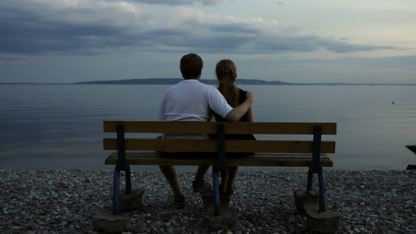 Video Bench Part - 48: Couple Watching River In The Evening - 4K Stock Footage Clip