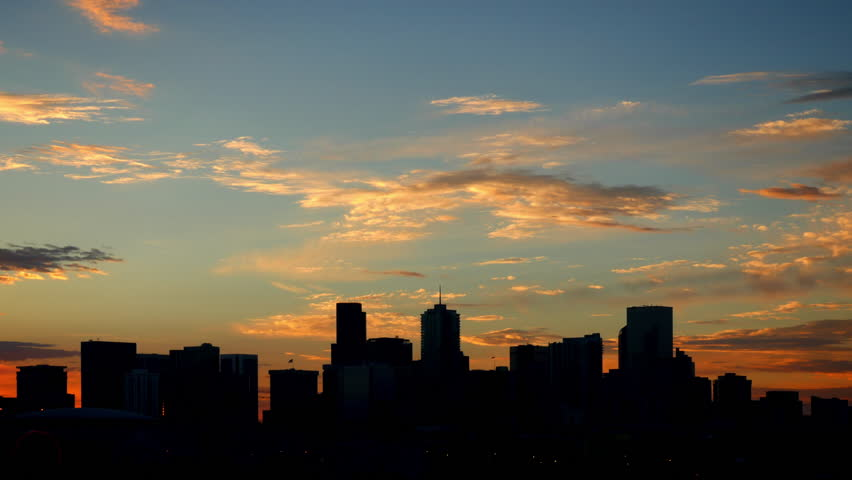 Denver Skyline Silhouette Time Lapse with glowing clouds at sunrise. 4K UHD. | Shutterstock HD Video #18285439