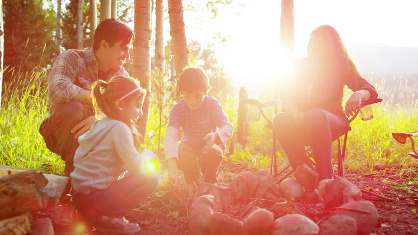 Happy Caucasian parent and children enjoying camping in woodland outdoor #18305656