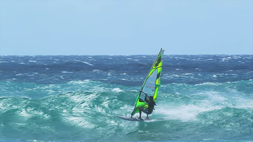 MAUI, HI - MARCH 13: Professional windsurfer Dean Christiner rides a large wave. March 13, 2011 in Maui, HI.