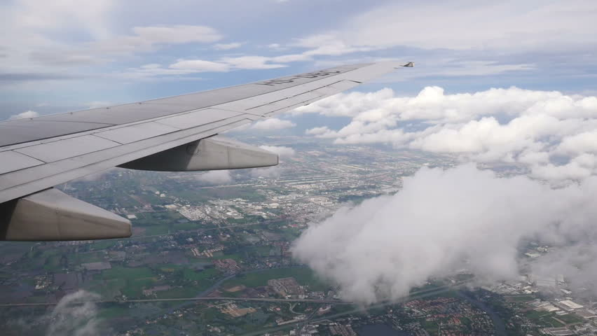 View from window seat of an airplane.airplane wing with blue sky and cloud #18391756