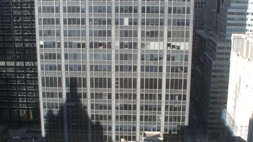 A square-on time-lapse of shadows moving across a building in New York City. #1840456