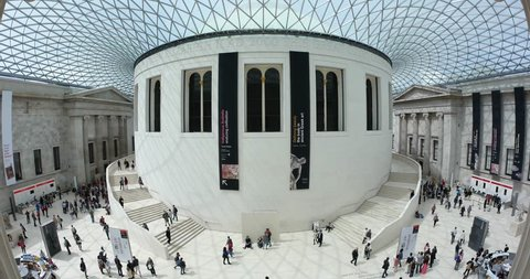 LONDON, UNITED KINGDOM - JUNE 22, 2015: People walking inside British Museum. The British Museum's collections number more than 7 million objects from all over the world.