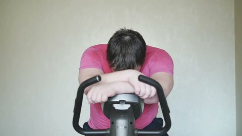 Overweight men survived on a exercise bicycle, and happy about it