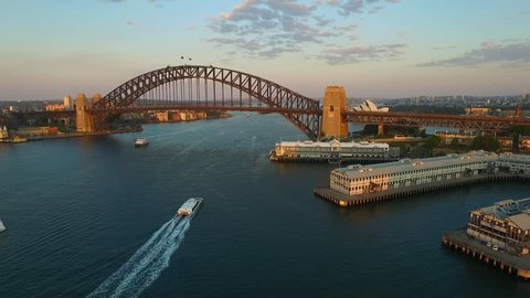 Aerial footage of Sydney Harbour Bridge, from helicopter featuring Sydney CBD, Sydney Ferries (ferry), with Sydney Skyline in Background & Ferries in Foreground, on the Parramatta River.