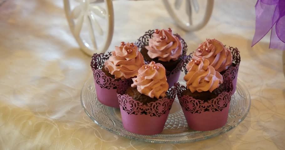 Sweet cream and chocolate muffins | Shutterstock HD Video #18486976