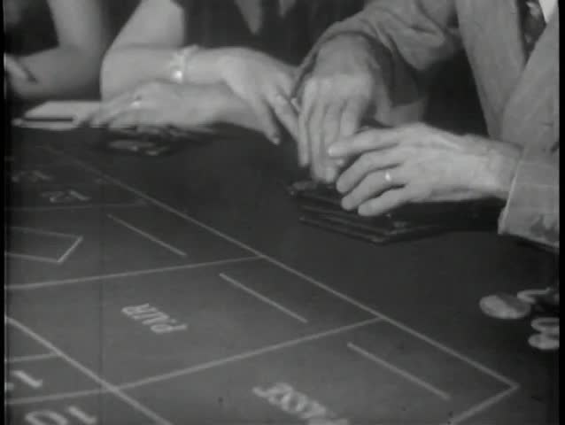 Close-up of hands playing roulette in casino