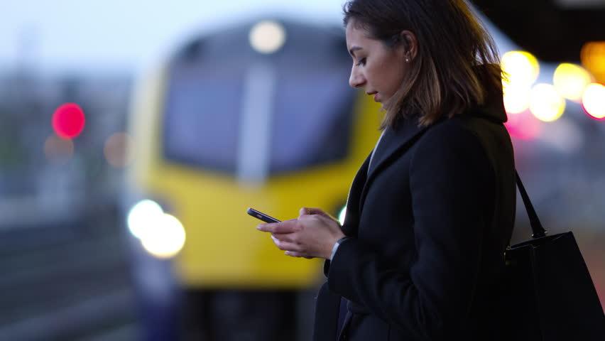 Businesswoman On Platform Waiting For Train Shot On R3D   Shutterstock HD Video #18550352