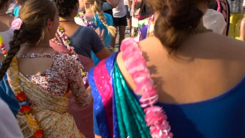 Holiday Krishna. Women Dancing in Indian Sari Dress. Slow Motion