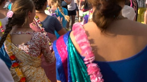 Holiday Krishna. Women Dancing in Indian Sari Dress. Slow Motion