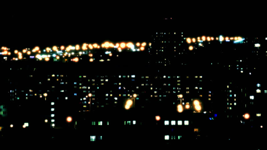 Night City Lights / Big City Landscape / Night Life. City lights twinkle, windows of high-rise buildings light up and go out, cars with headlights drive on roads. (av31673c)