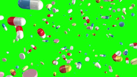 Pills and capsules falling on a chroma key greenscreen background. Loop section from 10:00 to 20:00, so you can have the pills falling for as long as you like. Medicine, medical, pharmaceuticals.