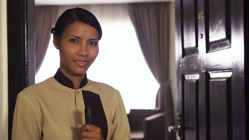 Portrait of happy Asian housemaid at work in luxury hotel room and smiling at camera. Young people at work, woman, girl, job, professions