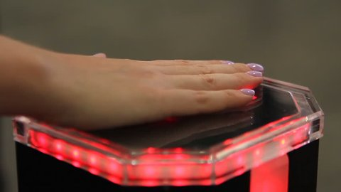Female palm on innovative identification equipment, biometrics authentication